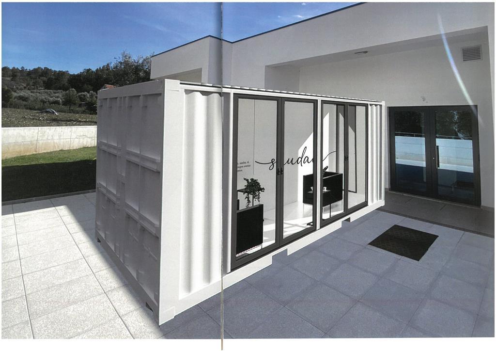 O projeto recorre a contentores marítimos transformados numa caixa de vidro. Foto: DR